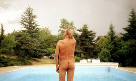 A nudist by a swiming pool in France