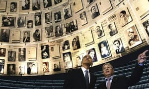 Barack Obama is escorted through the hall of names at the Yad Vashem Holocaust history museum in Jerusalem
