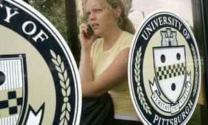 A student talks on her mobile at Pittsburgh University, where the cancer institute is based
