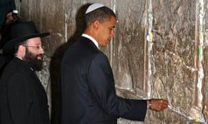 Senator Barack Obama places a note in the Western Wall in Jerusalem's Old City
