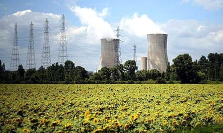 A field of sunflowers in front of the Areva Tricastin nuclear plant in in Bollene, in the south of France