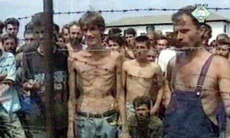 A still image from video footage showing emaciated prisoners at the Trnopolje concentration camp in Bosnia in the summer of 1992