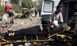 A badly injured victim is taken to hospital in Baghdad