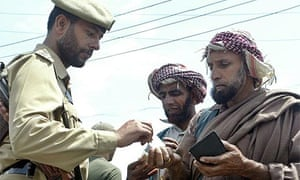 Kashmiri men show their passports to an Indian policeman in Srinigar as tension grows in the region. Scoopt/Getty