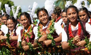 Tongan students wearing seed necklaces perform a dance for King George Tupou V during celebrations in the capital, Nuku'alofa. The monarch will be formally installed as the 23rd ruler of the South Pacific's only absolute aristocracy at a coronation ceremony on August 1