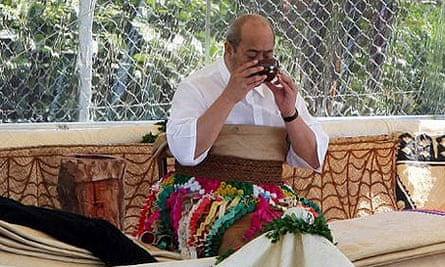 George Tupou V of Tonga drinks a coconut shell of kava  at his coronation