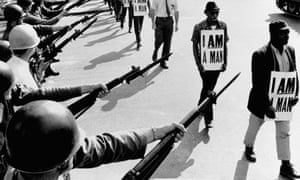 Civil Rights activists are blocked by National Guardsmen brandishing bayonets while trying to stage a protest on Beale Street in Memphis, Tennessee. March 19, 1968, Memphis, Tennessee, USA.
