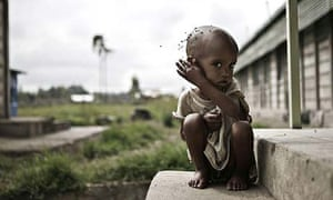 A child waits at a food centre in southern Ethiopia