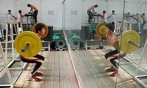 Olympic training: A man practices weightlifting ahead of the start of the 2008 Games