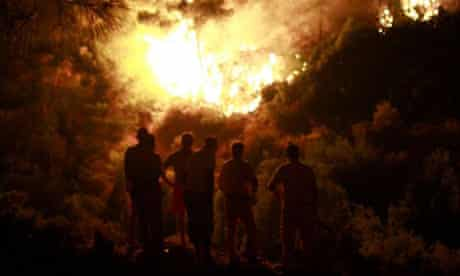 Turkish fire fighters struggle to extinguish fires engulfing woodlands in the coastal tourism province of Antalya