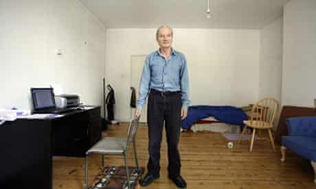 Author John Healy in his council flat in London