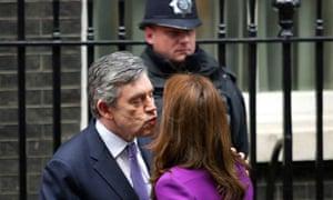 Prime Minister Gordon Brown kissing Carla Bruni-Sarkozy