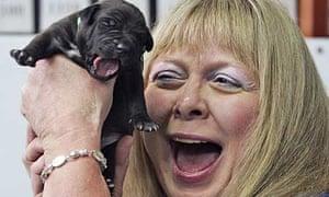 Bernann McKinney holds one of her five cloned puppies
