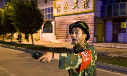 A member of the Chinese security services guards the site of the terrorist attack in Kashgar