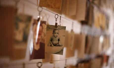 A photograph of a child on display amid a gallery of genocide victims in the Kigali memorial centre in Rwanda