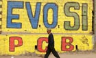 A man walks past a banner in Bolivia which reads 'Evo, yes'