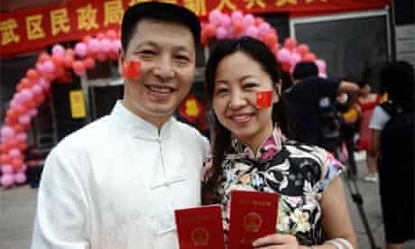 A Chinese couple following their wedding on the first day of the Beijing Olympics