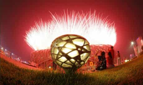 Fireworks explode over the National Stadium during the opening ceremony for the 2008 Olympic Games in Beijing