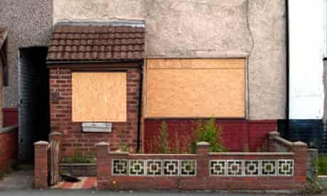 Boarded up house