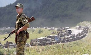 A Russian soldier on patrol as an armoured column waits outside Tskhinvali, South Ossetia