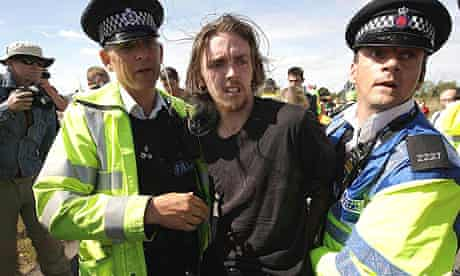 Police officers scuffle with climate change protesters near Kingsnorth power station in Kent