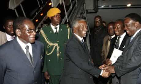 Thabo Mbeki next to Robert Mugabe