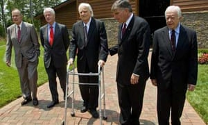 Former US presidents George Bush, Bill Clinton and Jimmy Carter walk with evangelist Billy Graham and Franklin Graham. Photograph: Chris Keane/Reuters