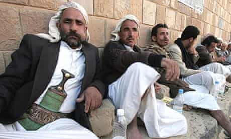 Yemeni men relax in the shade chewing qat, a mild drug used daily by most Yemenis