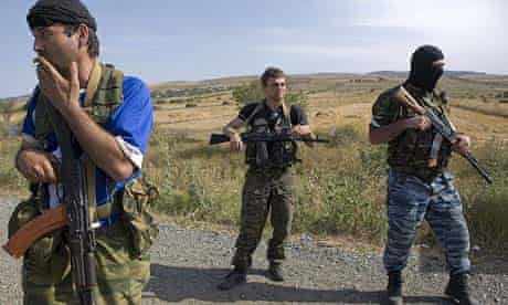Paramilitary troops following Russian soldiers as they leave Gori in a military convoy
