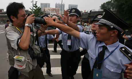 Dan Chung is hassled by Beijing police