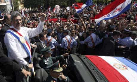 Paraguay's president Fernando Lugo greets the crowd after his swearing-in ceremony in Asuncion. Photograph: Ivan Alvarado/Reuters