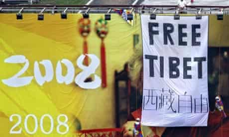 "Pro Tibet activists unfurl a ""Free Tibet"" banner"