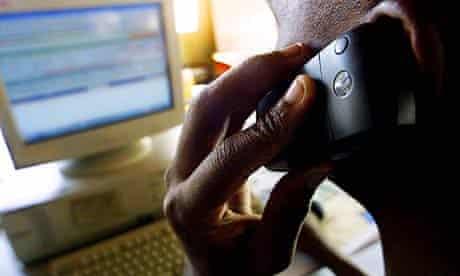 A man on the phone at an internet cafe in Nairobi, Kenya