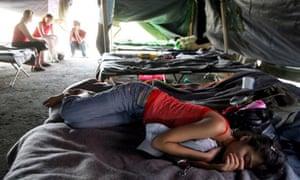 Georgian refugees rest in a camp near Tbilisi