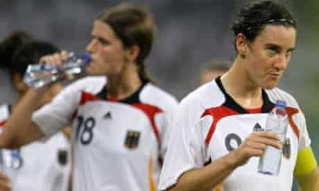 Germany's Birgit Prinz, right, and her teammates drink water during a break in their soccer semifinals match at the Beijing 2008 Olympics in Shanghai