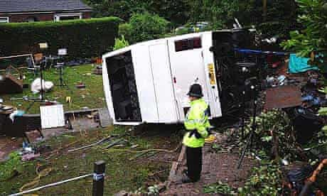 The scene in the village of Alton, Staffordshire, where a coach came off a bridge and plunged into a garden.