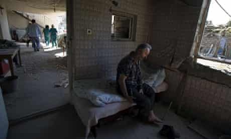 Tenguiz Teudorashvili is left in his wrecked house after being visited by medics in the villiage of Kabri north of Gori in Georgia