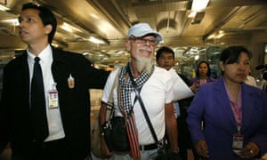 British rocker Gary Glitter walks towards an airline gate at Bangkok's Suvarnabhumi airport where he refused to board a plane back to the UK