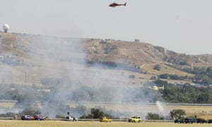Emergency services attend the crash site at Baraja ariport near Madrid, Spain.