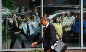 Fans greet Barack Obama as he arrives at the Sheraton hotel in Raleigh, North Carolina