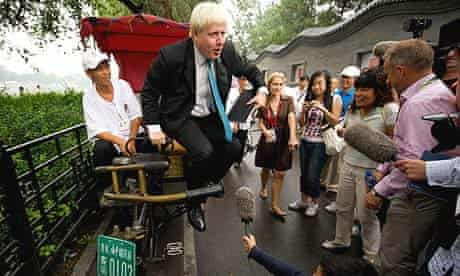 The mayor of London, Boris Johnson, gets out of a rickshaw as he arrives at London House at Houhai lake in Beijing