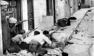 Republicans fighting in a Spanish village in the late 1930s. Photograph: AFP/Getty Images