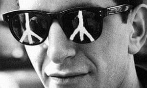 A protestor wears the CND symbol on his sunglasses during a 'Ban the Bomb' march from the Atomic Weapons Research Establishment in Aldermaston to Trafalgar Square, 18th April 1960