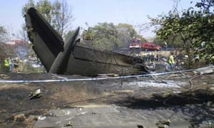 The charred tail section of the crashed SpanAir plane at Madrid's Barajas airport