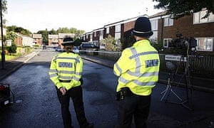 Police officers at the scene in Hockley Close in Newtown, Birmingham where a 24-year-old man was shot dead