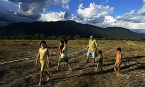 An indigenous Macuxi family walks in the Raposa Serra do Sol reservation in Roraima state, Brazil
