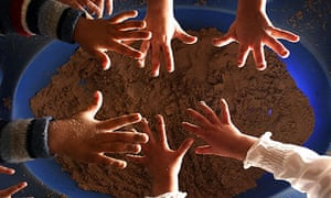 Children play with sand
