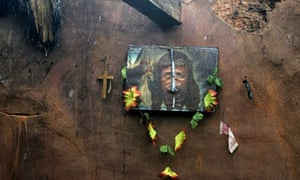 A defaced portrait of Jesus hangs on the wall of a Christian house after mob violence in Orissa, India