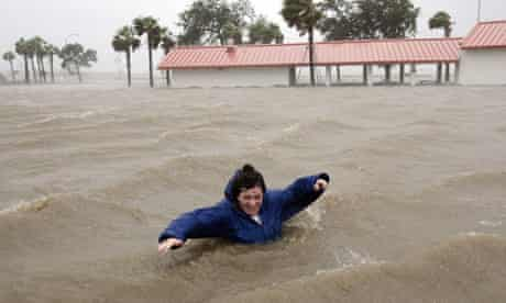 A woman walks through flood waters in New Orleans