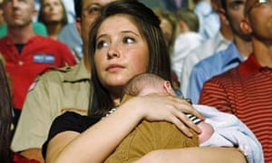 Bristol Palin holding her brother Trig at a campaign event